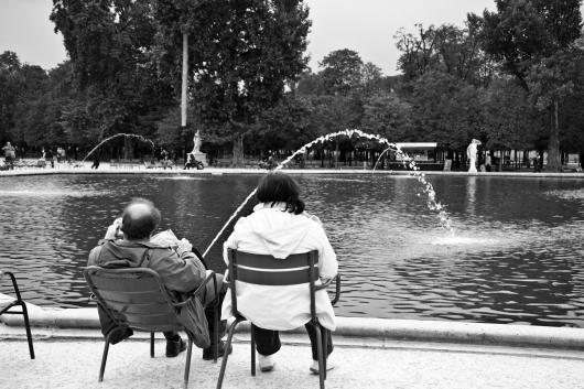A couple relaxing in the garden des tuileries in Paris October 2010.